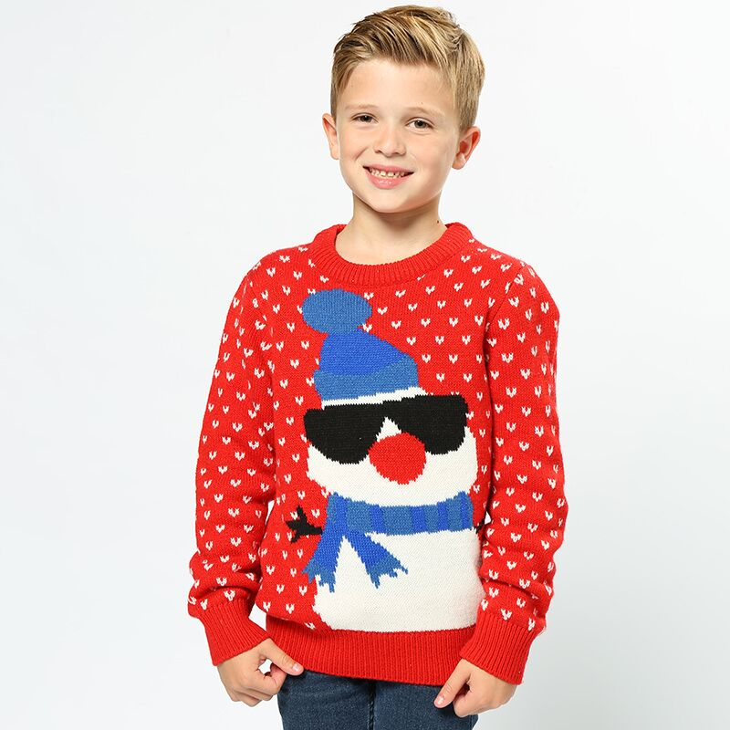 boy in christmas jumoper