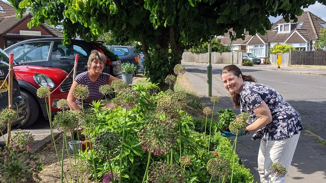 Clanfield Gardening Club digging in colourful plants